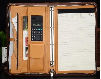 Sổ tay cao cấp bằng da PU với thiết kế dây kéo; máy tính và túi nhỏ bên trong